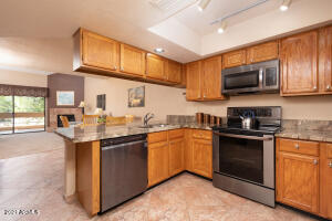 SS appliances & sink, granite counters and lots of pantry cupboards