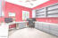 Bedroom 4 Office with walk in closet, built in cabinets, granite counters, view to courtyard
