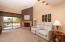 Living Room w/wood burning fireplace & generous size balcony patio