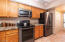 Stainless Steel appliances new in 2017, laundry closet in background