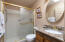 Hall bathroom with step-in shower & mirrored sundries cabinet