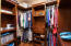 CUSTOM walk-in closet with a variety of storage options!