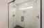 Beautiful, spacious shower in the primary bathroom has dual shower heads and dual controls