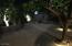 Back yard pavers at night with night time lighting