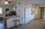 Corian work counter divides vaulted LR from Kitchen