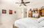 Owners Suite Bedroom with Backyard Access, Ceiling Fan/Light, Spacious Walk-In Closet w/Built In Shelving, En Suite Bathroom, Dual Sinks, Framed Mirror, Soaking Tub, Separate Shower, Separate Toilet Room