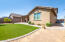 Spacious South Facing Backyard with Desert Landscaping, Faux Grass, Built In Irrigation System & Gorgeous Pavers leading to East side of Home for easy access to RV Gate, A/C Units & Bin Receptacles