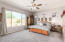 Master Bedroom faces a large grassy area and is SPLIT from the remaining 2 full bedrooms, bonus craft/storage room, and office/game room