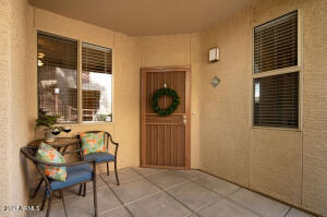 Gorgeous courtyard entry and the screen door is nice to let in the breeze.