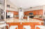 Open Plan Kitchen with High End Granite Countertops and Backsplash