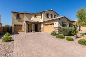 Tuscan elevation and beautiful pavers on driveway to split 3 car garage