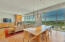 Dining room with a wall of windows and views
