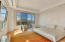 Large Master Bedroom with sitting area and surrounded by unobstructed views.