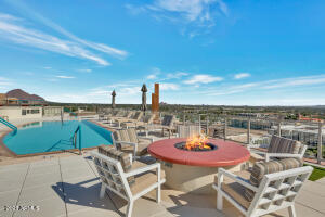 Roof Top Pool area with fireplace and BBQ area