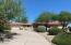 Circular drive up to custom home with wonderful landscaping