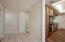 your front door view, kitchen to the right, entryway and to the front room