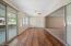 Flex space, entertaining room between living room and AZ room
