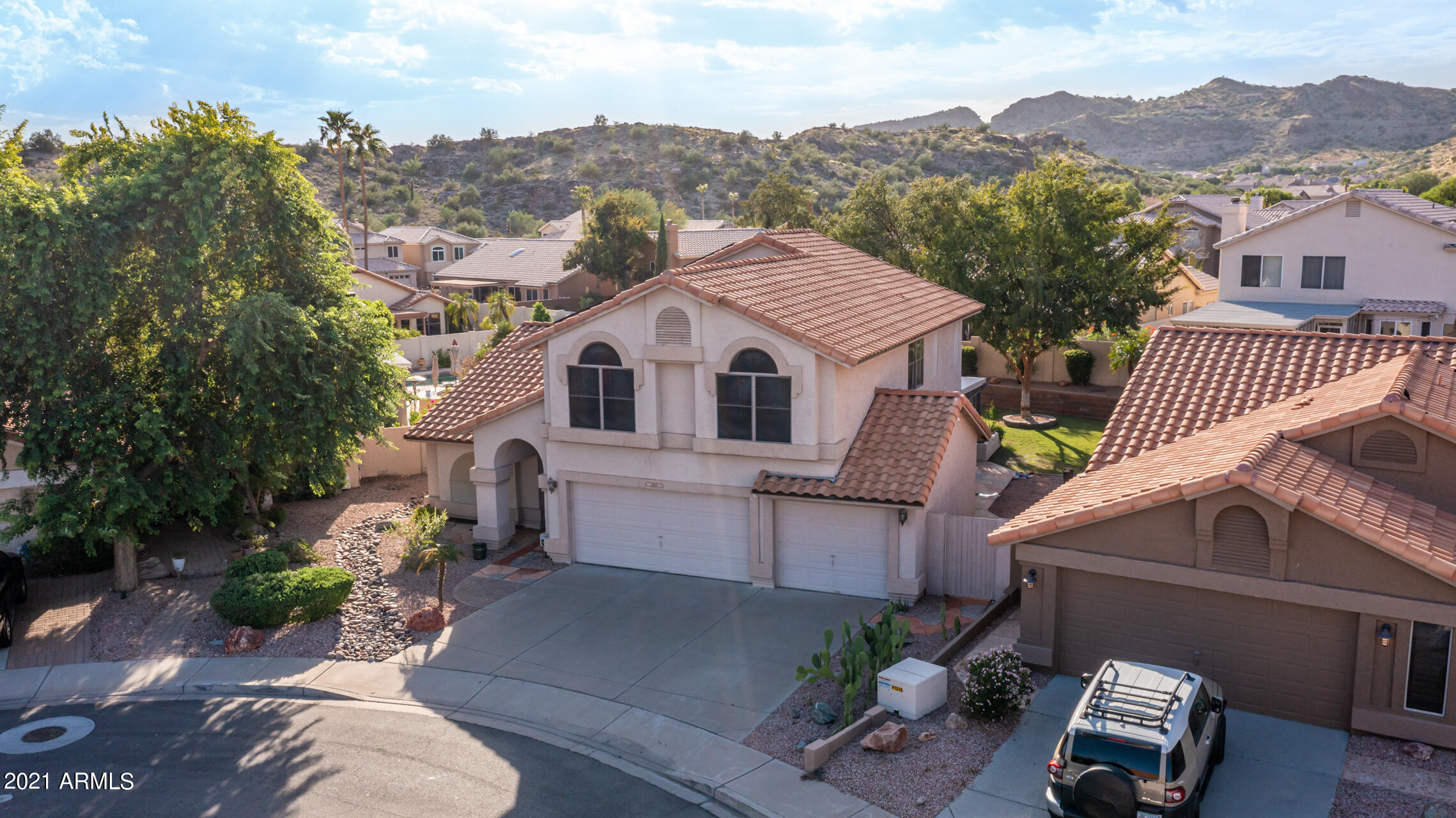 Nestled in Ahwatukee's Mountain Park Ranch, this 2,561 sf, 4BR/2.5BA is situated on an outstanding oversized lot w/ preserve views. Enjoy the huge covered patio, grass yard w/ mature trees, fire pit, & large pool, offering year round enjoyment outside! Inside, you'll find a spacious & open floorplan w/ flexible space options downstairs, & 4 large bedrooms upstairs. Master is well-appointed w/ large shower, freestanding claw foot tub, double vanities & walk-in closet. Secondary beds are well-sized, & share the remodeled bath done this year. 3-car garage w/ fridge, cabinets & shelving. Mountain Park Ranch offers multiple pools, children's play areas, tennis, pickle ball, & half-basketball courts, with hiking/bike trails & parks nearby. Minutes to 202/I-10 freeways, shopping & much more!