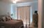 Spacious 2nd bedroom with ceiling fan and light!