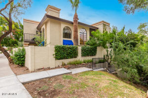 Gorgeous Spanish Mediterranean villa with two front balconies and private walkway.