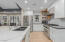 Kitchen with quartz countertops. Gas Stove with
