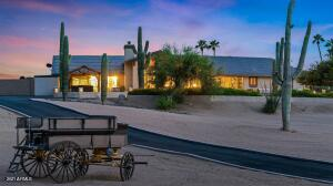 Beautiful home setting with desert plants strategically positioned on the property