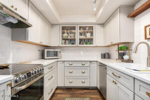 Wonderful Kitchen with Kraftmaid Shaker Cabinets with wide deep drawers and quartz countertops