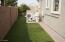 Side Yard has artificial grass.
