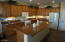 View of Kitchen Center Island & surrounding cabinet/counter area.