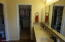 Dual vanity, private toilet room & large walk-in closet of main bedroom/bath.