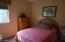 Bedroom #2 is roomy with sliding mirrored doors.