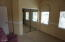 Bedroom #3 is at the front of the house. Spacious with sliding mirrored doors.