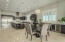 Amazing eat in kitchen with high end appliances, a spacious island, wine fridge, beverage fridge & ice maker.