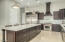 Stunning gourmet kitchen with WOLF gas stove, Sub-Zero fridge & freezer, WOLF electric wall oven & microwave.