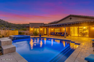 Enjoy the temperature controlled pool & spa or relax on the covered patio with misters & audio.