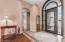 Custom arched iron doorway welcomes guests to your new home.