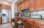Pull-outs in the kitchen cabinets offer easy access to pots and pans.