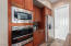 Sleek stainless wall oven and microwave add elegance to the kitchen.
