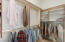 The second, smaller walk-in closet is large and spacious. All closets are outfitted with custom closet built-ins.