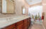 The hall bathroom is large and easy to share with double vanities.