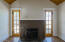 Living room fireplace and dual French doors