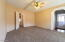 Large owner's suite with new carpet and ceiling fan.