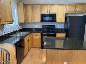Beautifully refreshed Kitchen with granite counters and decorative backsplash!