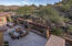Showing back patio and slightly sloping hill to back where you can add casita/additional parking etc.