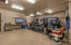 Huge Storage room and workshop area as well as epoxy garage floor make this the man-cave to dream of!