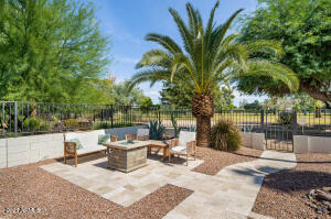 Great sitting area with firepit and patio furniture great view of the golf course