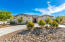 Beautiful semi circle concrete driveway and 2 RV gates one on each side. With long concreted driveway on the side. RV pad behind RV gate on driveway side.