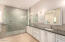 Look at this shower! Massive and beautiful! Dual sinks and plenty of cabinets.