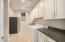 You will love this laundry room! Talk about massive and again cabinets galore with tons of space! Security cameras and screens in this room as well which leads to the garage.