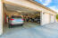 2 car door in the 4 car over sized garage with oversized doors and a 12 ft ceilings. Epoxy coated flooring as well.